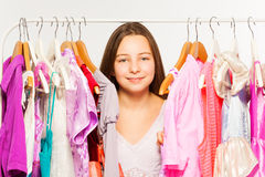 Girl close-up view between hangers with dresses Royalty Free Stock Images