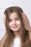 Girl with closed ears Stock Image