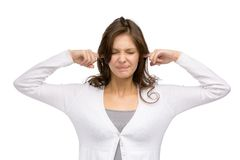 Girl with closed eyes closes her ears Royalty Free Stock Images
