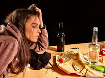 Girl with closed eyes in depression drinking Royalty Free Stock Images
