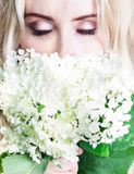 Girl with closed eyes with flowers Stock Images
