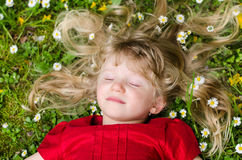 Girl with closed eyes and long blond hair relaxing Stock Photo