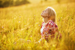 Girl with closed eyes in wildflowers Royalty Free Stock Photography