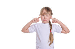 The girl closed fingers ears Stock Image
