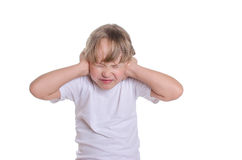 The girl closed hands ears from noise. Royalty Free Stock Image