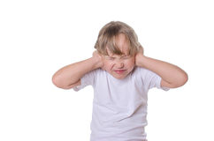 The girl closed hands ears from noise. Royalty Free Stock Photos