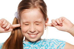 Girl closed her ears Stock Images