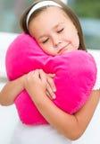 Girl closed her eyes dreaming. Little girl closed her eyes dreaming, holding a pillow Stock Image