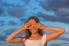 Girl closed his eyes with his hands Royalty Free Stock Photo
