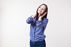 Girl closes ears hands listens to music royalty free stock photo