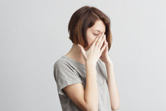 Girl closes in frustration her face. To be ill with influenza an. Forget and remember something, suffer from illness Royalty Free Stock Image