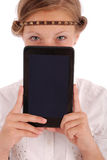 Girl closes the half face tablet pc Stock Image