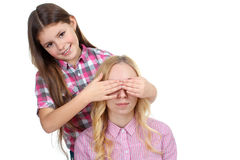 The girl closes her eyes sister Stock Photography