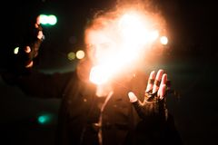 The girl closes her face with fire. For any purpose Royalty Free Stock Photos