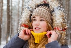 Girl raised her sweater collar in frosty weather. Girl closes her neck with a collar sweater in frosty weather royalty free stock photography