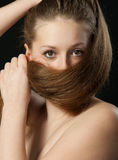 The girl closes long hair Stock Photo
