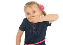 The girl closes mouth by hand Royalty Free Stock Photography