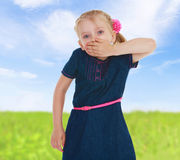Girl closes mouth by hand Royalty Free Stock Photo