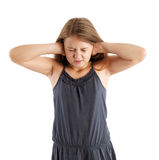 Girl closing her ears Stock Photo