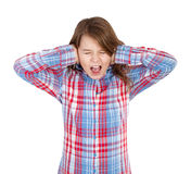 Girl closing her ears and screaming Royalty Free Stock Image