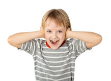 Girl closing her ears and screaming Stock Photo