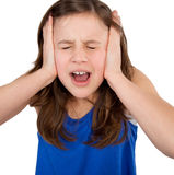Girl closing her ears and screaming Royalty Free Stock Images