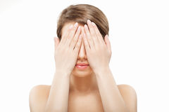 Girl closing her face with hands Stock Photo