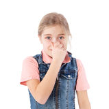Girl closing nose. Girl holding her nose because of a bad smell Royalty Free Stock Image