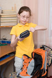 Girl closing pencil case Stock Photography