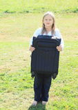 Girl holding suitcase Stock Image