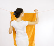 Girl with clothespin and the clothesline. Hanged clothes drying - girl with clothespin and the clothesline Stock Images