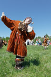 Girl in clothing aborigine of Kamchatka dancing on the green grass. Kamchatka, Russia Stock Image