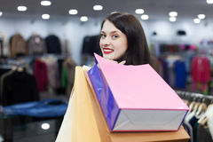 Girl at clothing shop. Girl  with shopping bags  at clothing shop Stock Photo