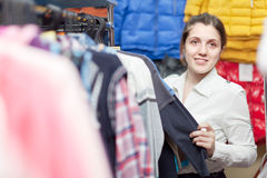 Girl at clothing store Stock Photography