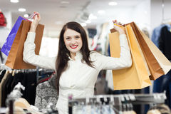 Girl  at clothing  store Stock Images