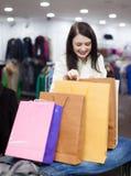 Girl  at clothing  store Royalty Free Stock Photo