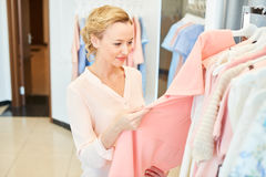 Girl in a clothing store royalty free stock images