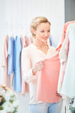 Girl in a clothing store royalty free stock image