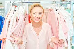 Girl in a clothing store royalty free stock photo