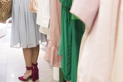 Girl in clothings the shop. stock images
