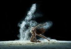 Girl in a cloud of white dust studio portrait Stock Photo