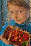 Girl and cloudberries Royalty Free Stock Photo