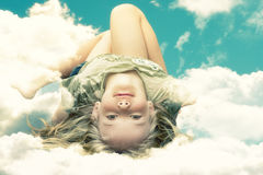 Girl on clouds Royalty Free Stock Photos