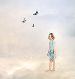 Girl in the Clouds Stock Photo