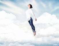 Girl in a clouds Royalty Free Stock Photography