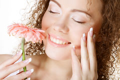 Girl with cloused eyes holding flower Stock Photos