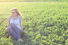 Girl on clover Stock Image