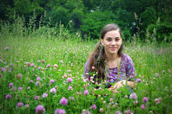 Girl in Clover Field Royalty Free Stock Image
