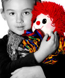 Girl with clown Stock Images