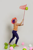 Girl clown and balloons Stock Photography